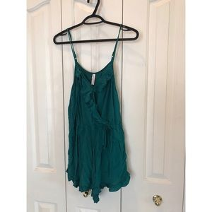 Green Romper with ruffles and pockets!